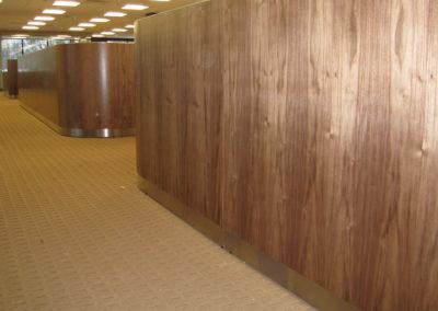 Walnut panels with metal plinth