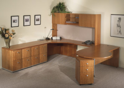 anigre private office with curved fronts on pedeestals