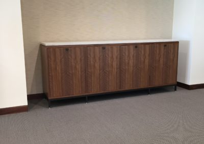 figured walnut and stone credenza